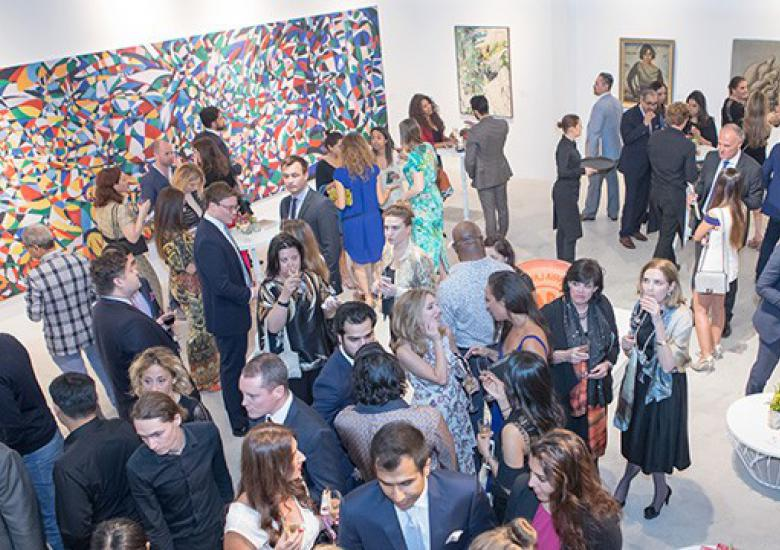 Crowd stands at Sothebys polished concrete